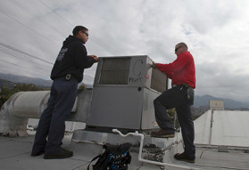 two Ajax employees installing A/C